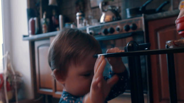 little baby playing near the table - giovane nell'animo video stock e b–roll