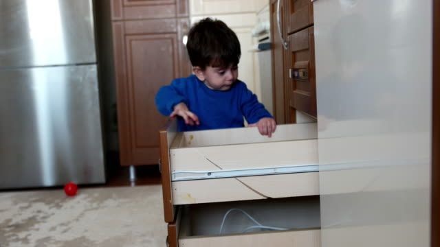 Little baby playing with household video