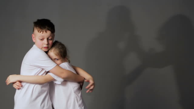 Little boy and girl and shadows of quarreling parents.