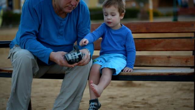 Little boy and his grandfather video