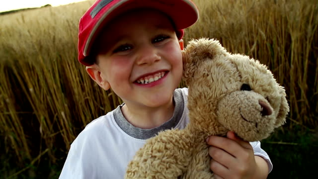 Little boy and his teddy friend