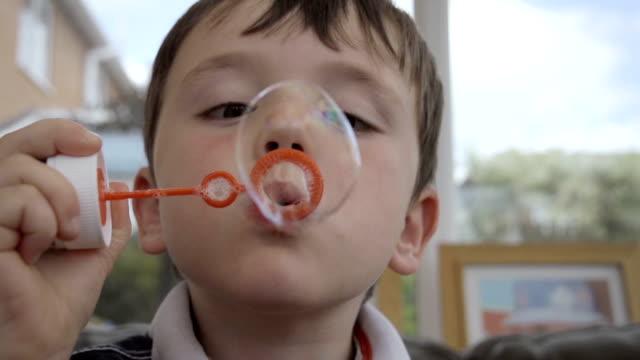 Little Boy Blowing Bubbles In slow Motion video