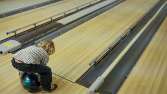 little boy bowling - young singles stock videos and b-roll footage