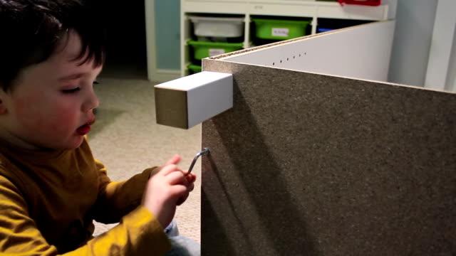 Little Boy Building A Self Assembled Wardrobe video