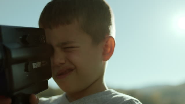 Little boy capturing the moment with his camera video