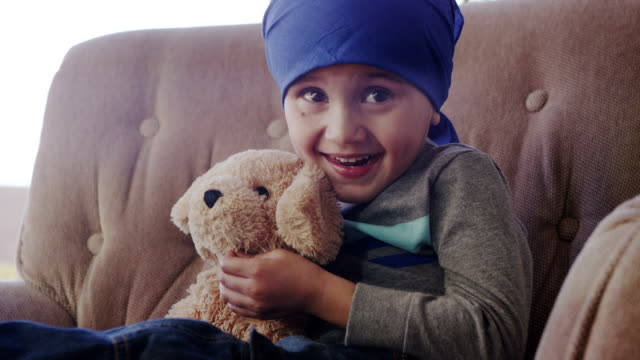 Little Boy Chemotherapy Little boy and his teddy bear after a chemotherapy treatment hope concept stock videos & royalty-free footage