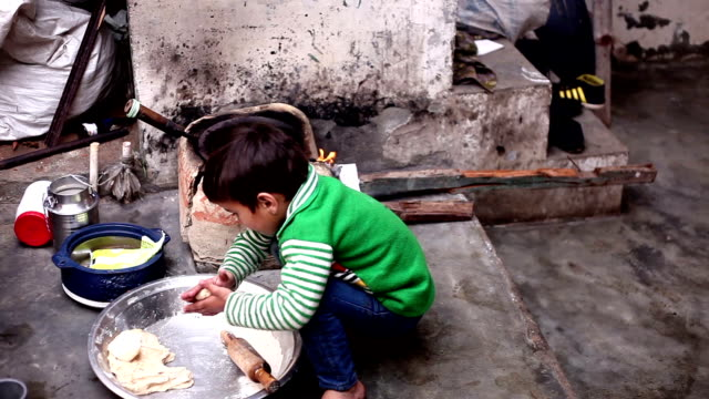 Little boy cooking food - video