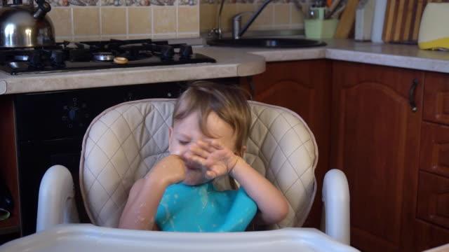 little boy dad feeds the porridge in the kitchen video