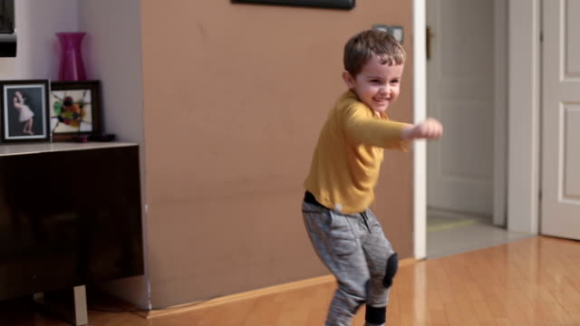 Little boy dancing and imitating boxer movements video