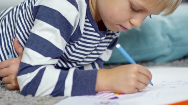 Little Boy Drawing with Blue Marker video