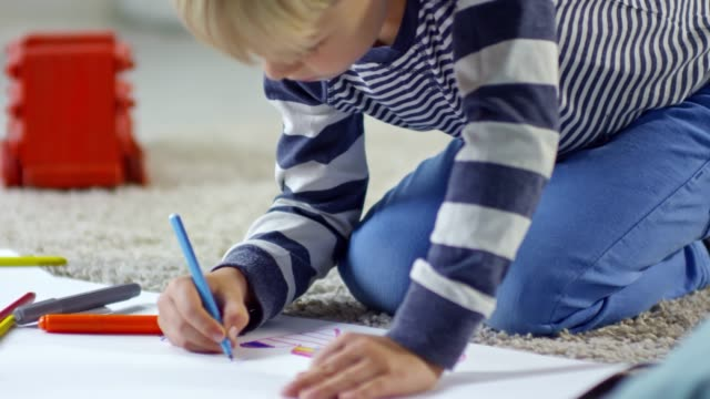 Little Boy Drawing with Colored Markers video