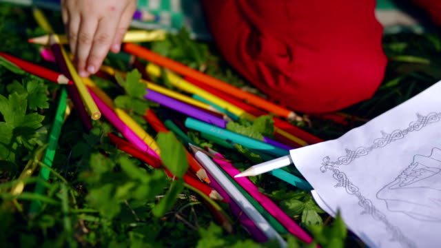 Little boy draws in the garden video