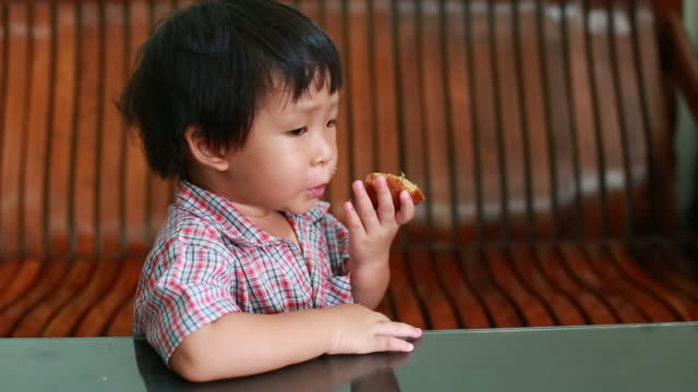 Little boy eating Banana Cake video