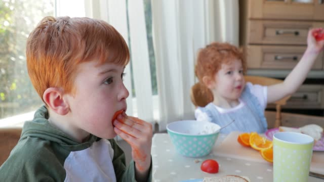 Little Boy Eating his Orange