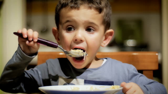 little boy eating soup portrait of a little boy at dinner time eating stock videos & royalty-free footage