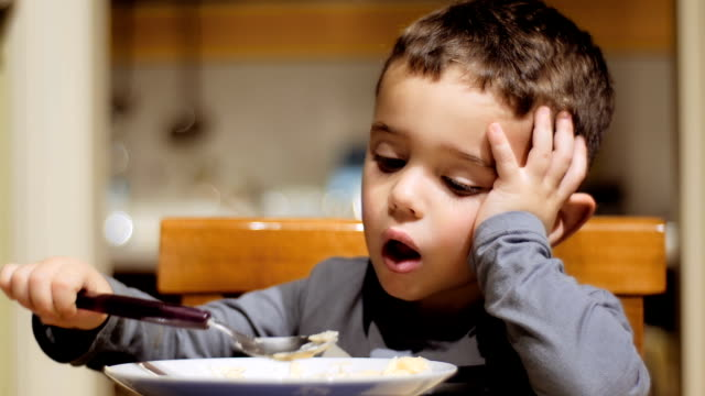 little boy eating soup portrait of a little boy at dinner time hungry child stock videos & royalty-free footage