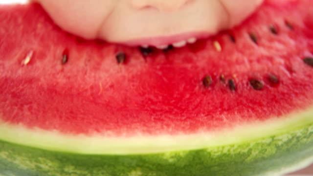 Little boy eats big red slice of a watermelon video