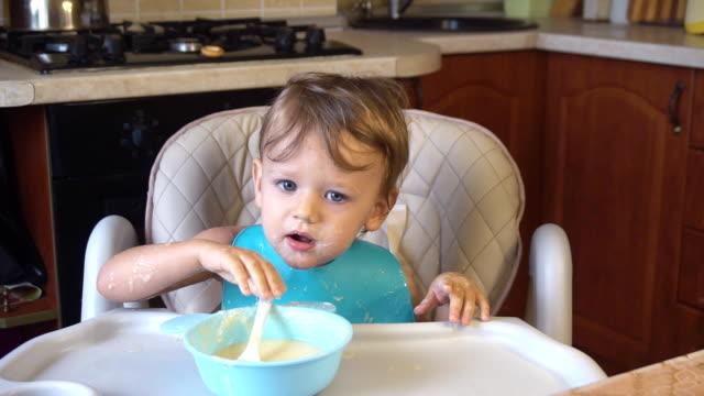 little boy eats porridge for breakfast video