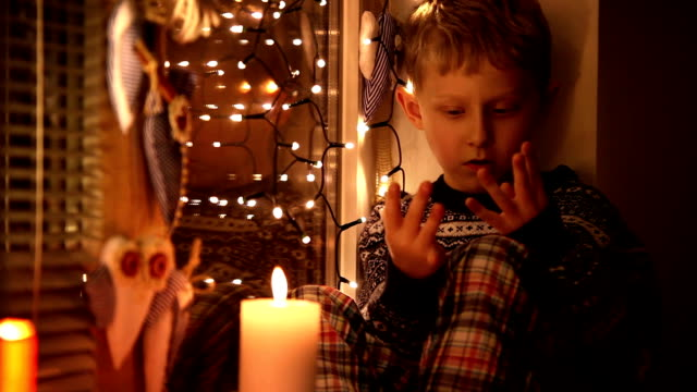 Little Boy Finger-counting how many presents will bring him Santa video