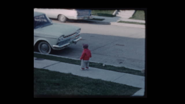 1960 Little boy gets out of antique car trips and falls down Little boy gets out of antique car trips and falls down tripping falling stock videos & royalty-free footage