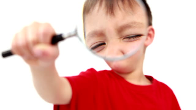 Little boy holding a magnifying glass Little boy holding a magnifying glass in high quality 4k format magnifying glass stock videos & royalty-free footage