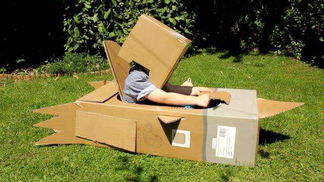 Little Boy In A Cardboard Rocket
