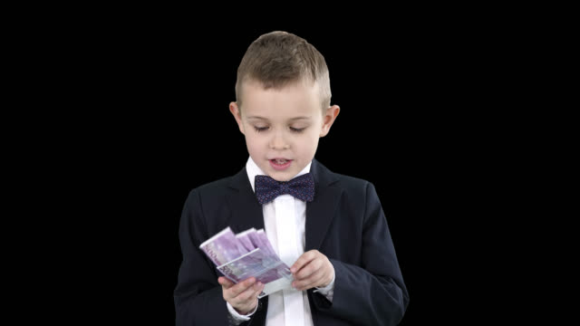 Little boy in a suit counting money, Alpha Channel