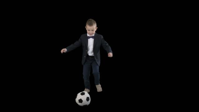 vídeos de stock e filmes b-roll de little boy in costume shooting at goal, alpha channel - campeão soccer football azul