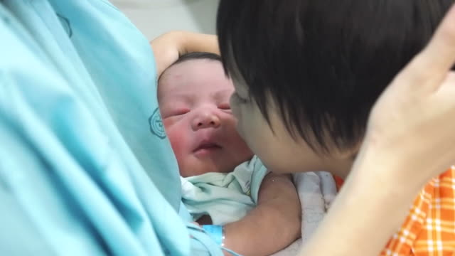 Little boy kissing his newborn brother video