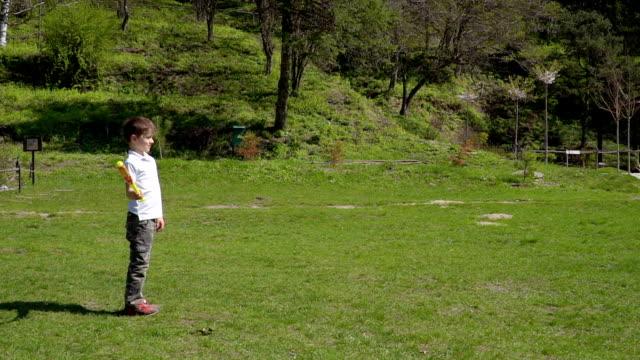 Little boy learn to play baseball video