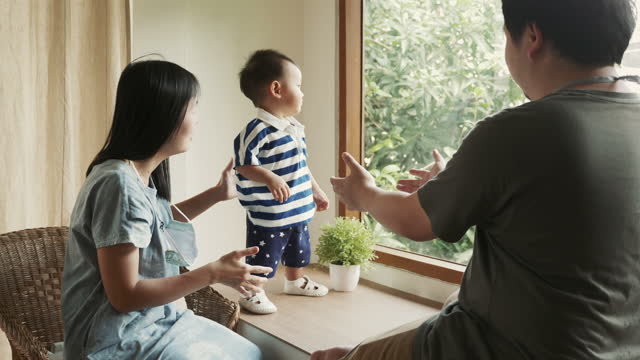 Little boy learning to walk Parents learning walk kid. Father holding child hands. Baby walking at home. Family support little kid. Baby learning to walk. 4K Resolution first occurrence stock videos & royalty-free footage
