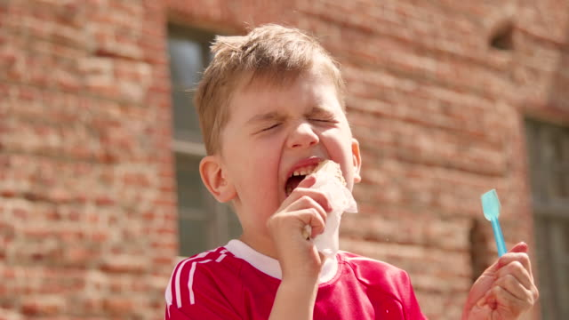 Little boy licking ice cream video