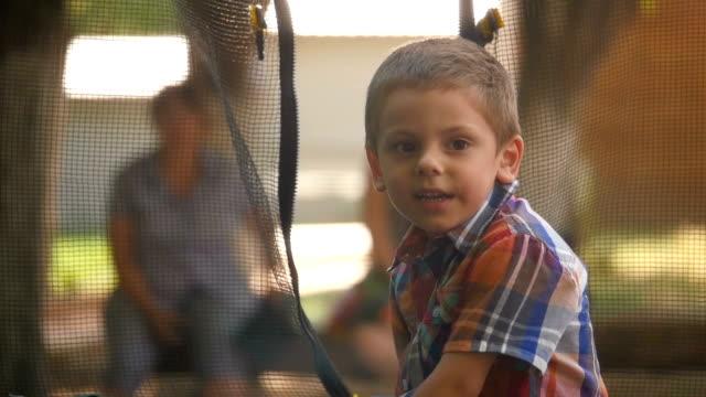 little boy on the playground video