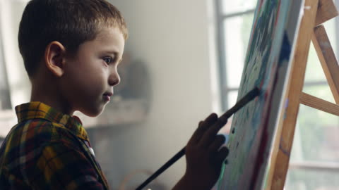 Little boy painting Little boy painting at the artist's studio art and craft stock videos & royalty-free footage