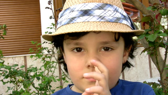 Little boy picking his nose Little boy picking his nose middle finger stock videos & royalty-free footage