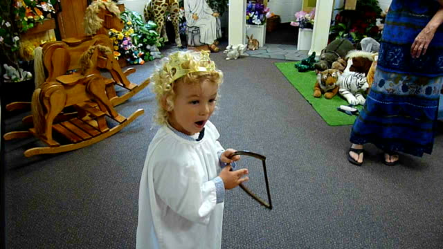 Little Boy Playing Harp