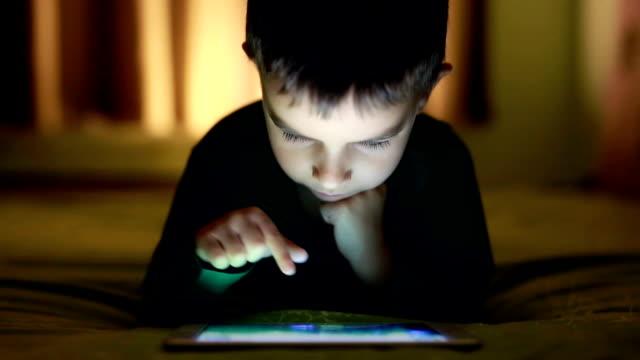 Little Boy playing on digital tablet