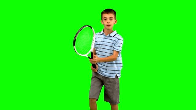 Little boy playing tennis on green screen video