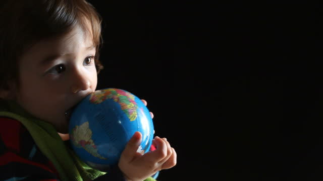 Little boy playing with globe video