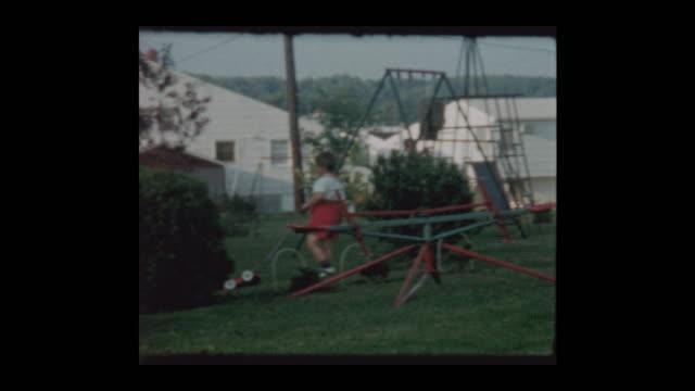 1961 little boy plays with toy lawn mower - hotel reception filmów i materiałów b-roll