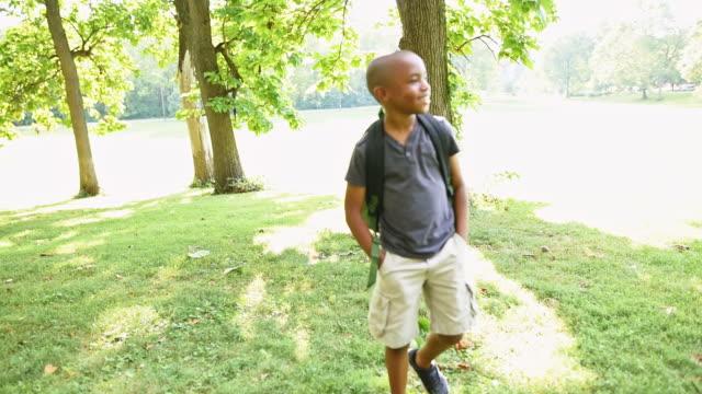little boy portrait student on the park - 8 9 anni video stock e b–roll