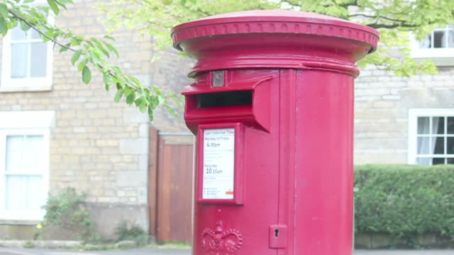 Little boy posting letter in red postbox video