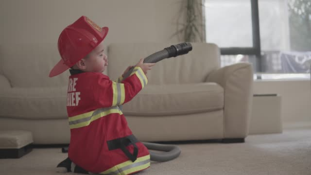 little boy pretending to be a fireman - firefighter stock videos and b-roll footage