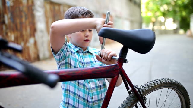 Little boy repairing a bicycle Little boy repairing a bicycle independence stock videos & royalty-free footage