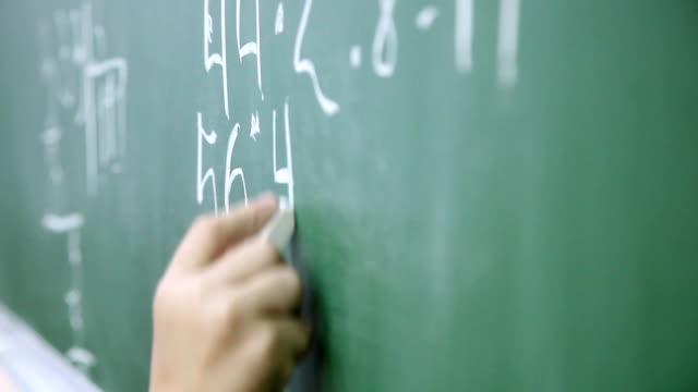 little boy solves math on the blackboard at school 3 video