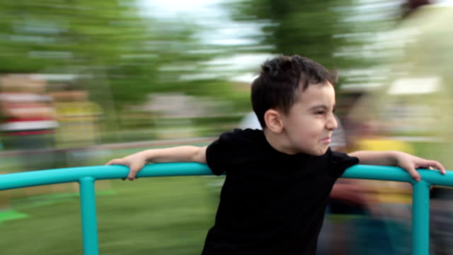 Little boy spinning on playground video