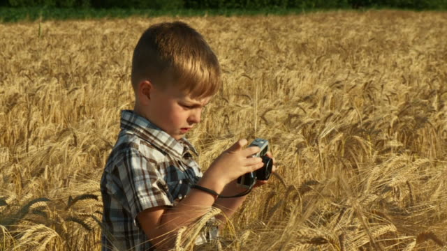 HD SLOW-MOTION: Little Boy Taking Pictures  camera photographic equipment stock videos & royalty-free footage