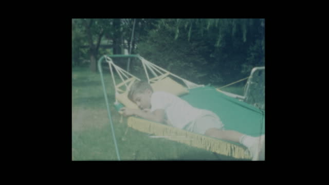 Little boy tips older brother out of hammock video
