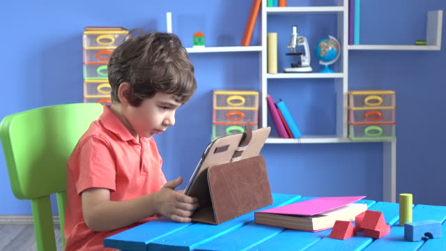 Little Boy Using Digital Tablet In His Room video