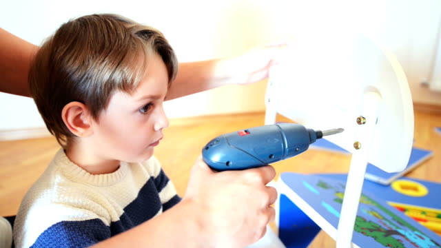 Little Boy using diy tool Little Boy using diy tool at home cordless phone stock videos & royalty-free footage